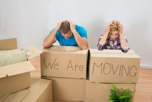 Stressed couple buying and selling property